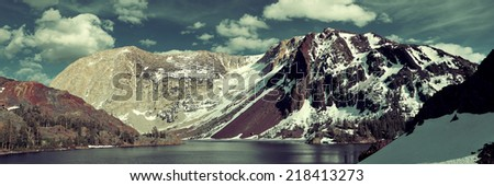 Snow mountain cloud and lake panorama with reflections in Yosemite. - stock photo