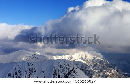 Snow mountains and blue sky with clouds. View from ski slopes. Caucasus Mountains, Georgia, region Gudauri. - stock photo