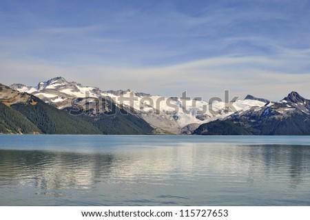 snow mountains  reflecting on Garibaldi Lake - stock photo