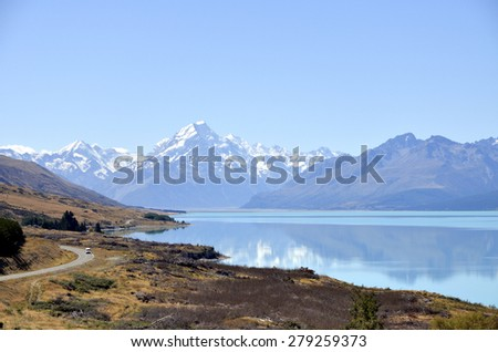 Snow mountains view on Wakatipu lake in New Zealand. - stock photo