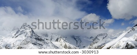 snow mountains with clouds - stock photo