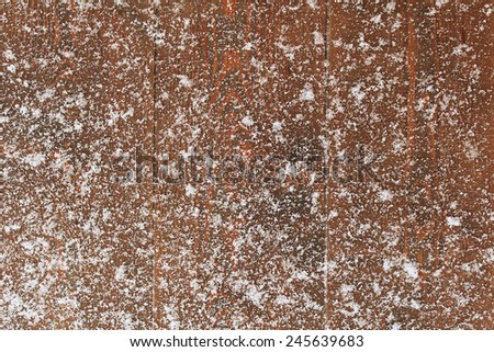 Snow on an old wooden background - stock photo