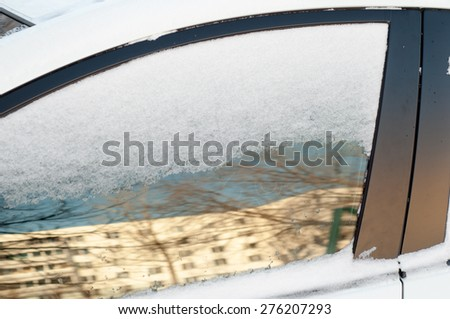 snow on the car. Cold January day - stock photo
