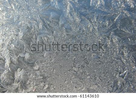 Snow pattern on winter window - stock photo