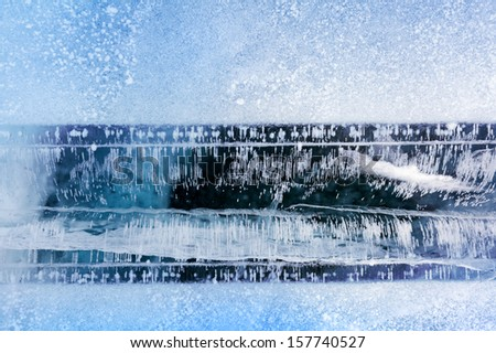 Snow pattern with a horizontal strip of ice - stock photo