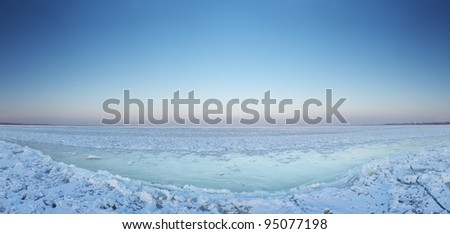 Snow plain and bright sky. Reflections on ice - stock photo