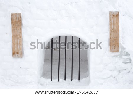 snow prison with wooden sign - stock photo