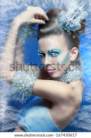 snow-queen. Young woman in creative image with silver blue artistic make-up and perfect hairstyle. - stock photo