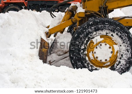 Snow removal vehicle removing snow - stock photo