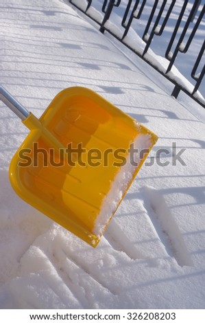 Snow Removal with shovel at winter cold - stock photo