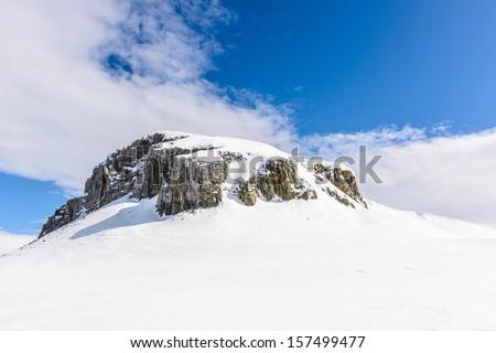 Snow rocks of the Half Moon Island, an Antarctic island, the South Shetland Islands of the Antarctic Peninsula region. - stock photo