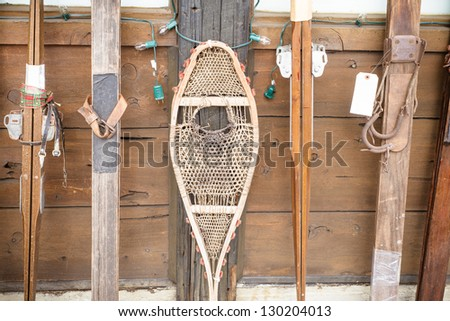 Snow Shoes and vintage skis  on display at winter resort - stock photo