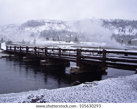 Snow storm over bridge in Yellowstone Park, USA - stock photo