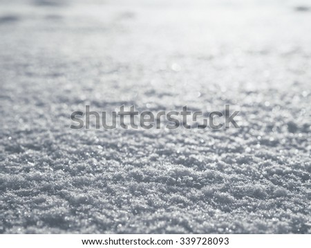 Snow surface close up macro, winter background, shallow depth of field - stock photo