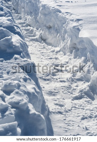 snow trench, path trodden by people after recently last snowfall - stock photo