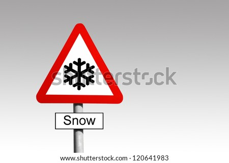Snow Warning triangle road sign against a grey sky - stock photo