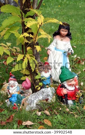 Snow White and Garden Gnomes - stock photo