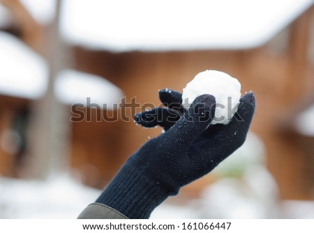 Snowball in palm - stock photo
