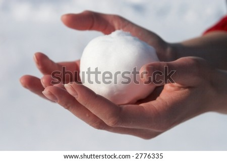 Snowball in the hand - stock photo