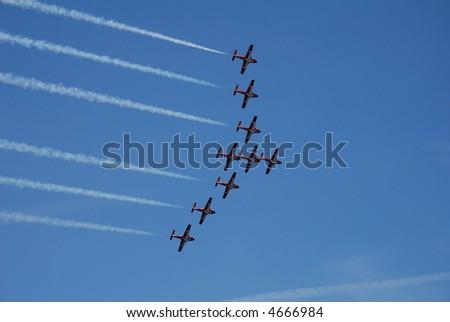 Snowbirds Tutor Jets in Formation - stock photo
