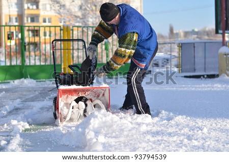 snowblower in winter - stock photo