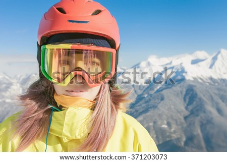 Snowboard. Female snowboarder or skier on the background of high snow-capped Alps in Swiss - stock photo