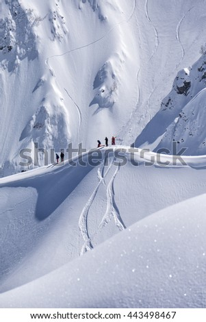 Snowboard freeride, snowboarders and tracks on a mountain slope. Extreme sport. - stock photo