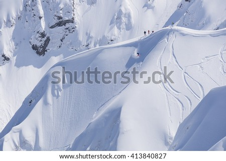Snowboard freeride, snowboarders and tracks on a mountain slope. Extreme winter sport. - stock photo