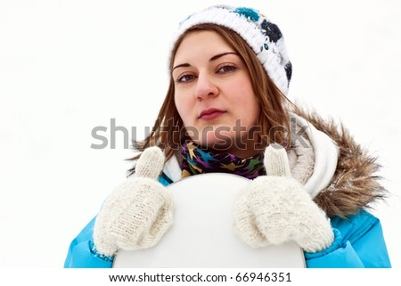 snowboard rider girl thumb up - stock photo