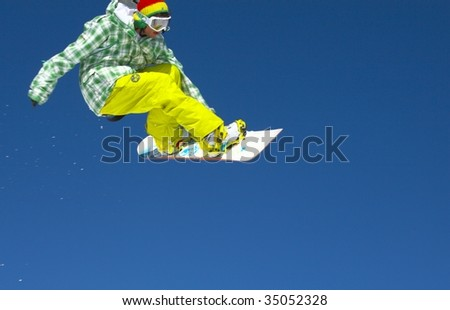 Snowboarder and a blue sky - stock photo