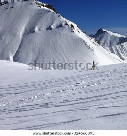 Snowboarder downhill on off piste slope with newly-fallen snow. Caucasus Mountains, Georgia, ski resort Gudauri. - stock photo