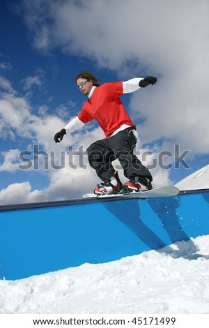 snowboarder flying through the air - stock photo