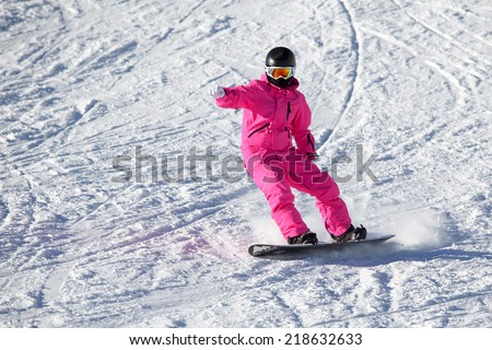 Snowboarder girl in the pink in the Alps - stock photo