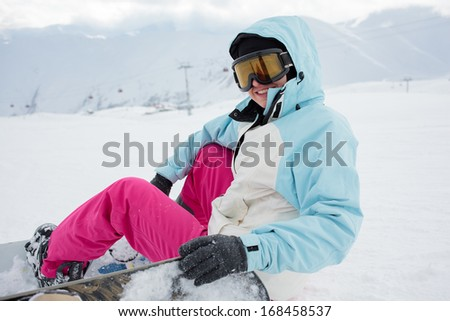 Snowboarder has fun in high winter mountains in Gudauri, Georgia - stock photo