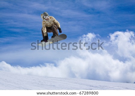 Snowboarder jumping high in the air - stock photo