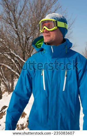 Snowboarder looking at the sun - stock photo