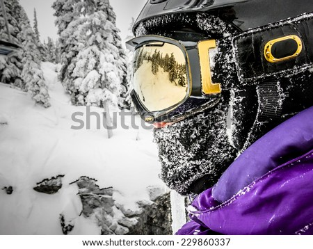 Snowboarder or Skier Side Profile Portrait Outdoors - stock photo