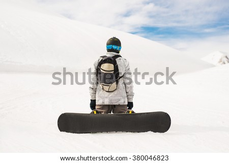 Snowboarder ready for slope. - stock photo