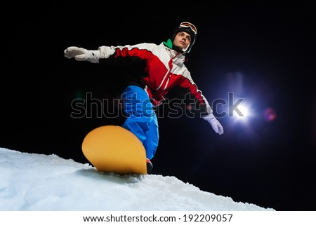 Snowboarder ready to slide down the mountain - stock photo