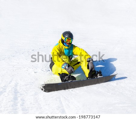 Snowboarder sitting on snow mountains, snowboarding slopes - stock photo