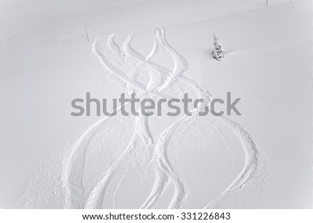 Snowboarders curves in the snow - stock photo