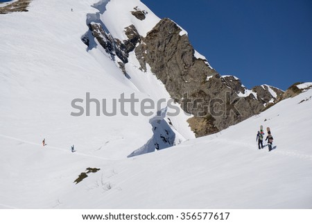 Snowboarders walking uphill for freeride, extreme sport - stock photo