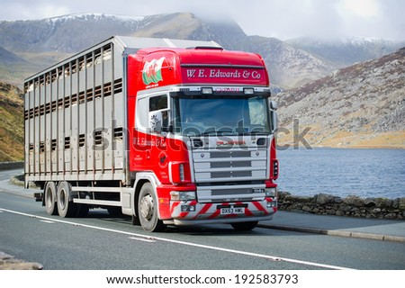 SNOWDONIA-MAR 25: Scania 114L truck on a road on Mar. 25, 2014 in Snowdonia, Wales, UK. Scania is a major Swedish automotive manufacturer of commercial vehicles - specifically heavy trucks and buses. - stock photo