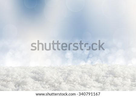 Snowdrift on abstract silver bokeh background - stock photo