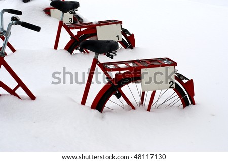 Snowed in bikes - stock photo