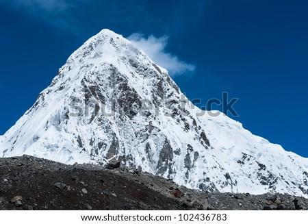 Snowed Pumori summit in Himalaya. Travel to Nepal - stock photo