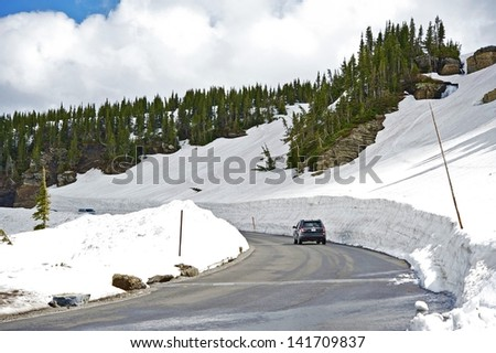Snowfields Road. Rocky Mountains National Park Road in Early Summer. Colorado, USA. - stock photo