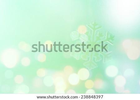 Snowflake big close up. Bokeh background. Toning is blue-green. - stock photo