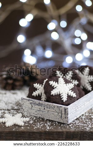 Snowflake, chocolate, Christmas cookies on old wood table - stock photo