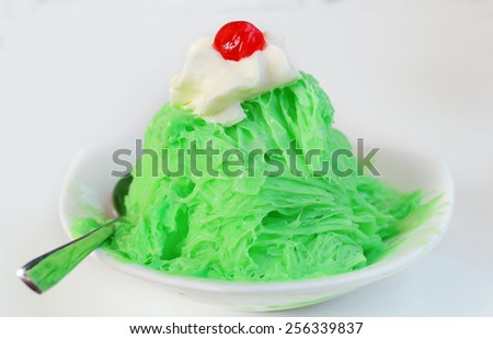 Snowflake ice cream flavor cantaloupe and whipping cream on white background - stock photo